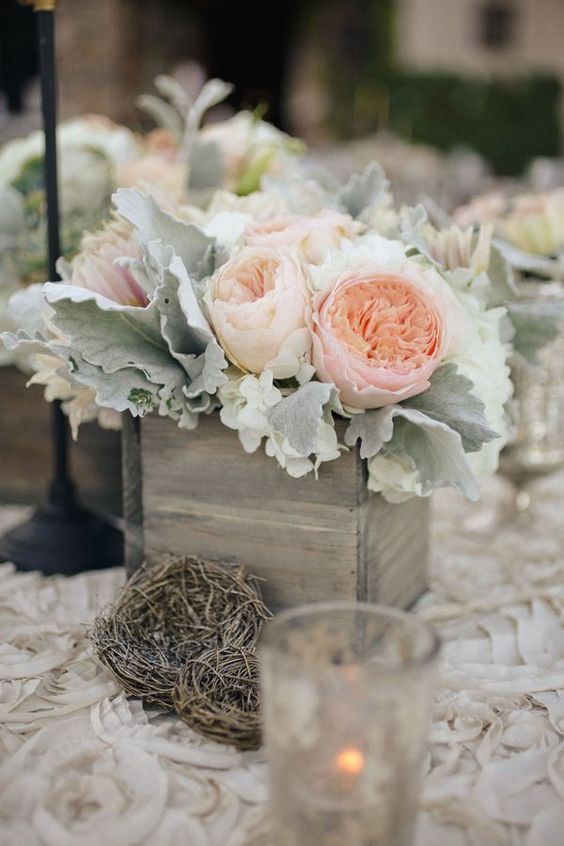 soft wedding centerpiece with dusty miller and blush peonies