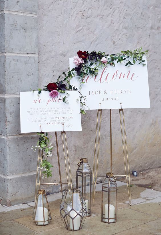 geometric candle lanterns and copper stands for signage