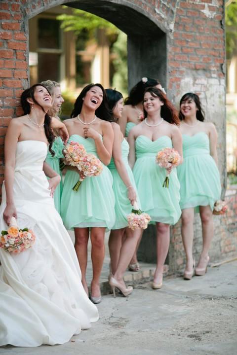 mint bridesmaids' dresses, peach bouquets