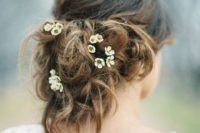 14 very messy updo with tiny fresh flowers tucked in
