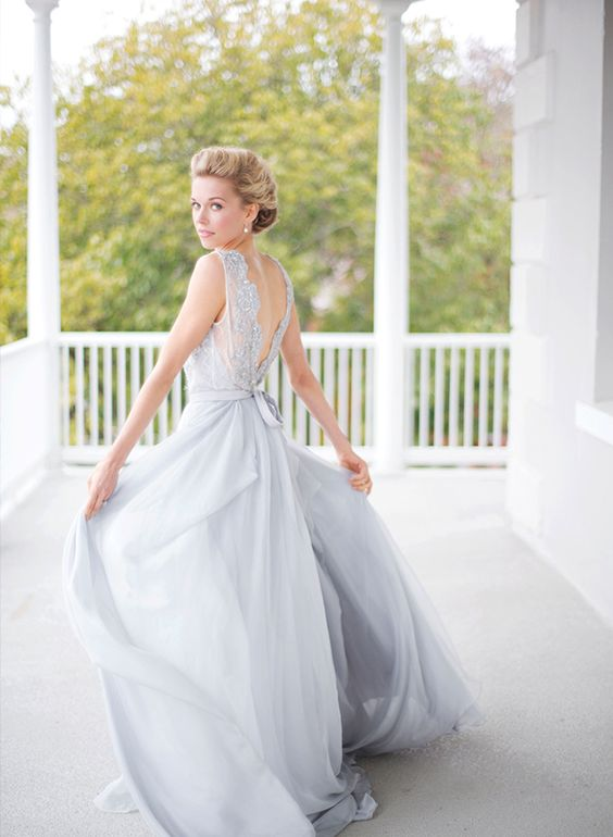 very pale blue wedding gown with greish tones and a statement back