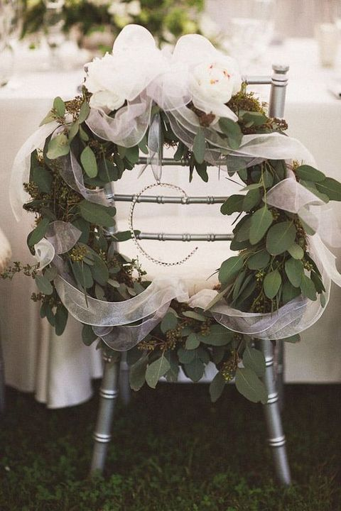large eucalyptus wreath with white tulle and a monogram