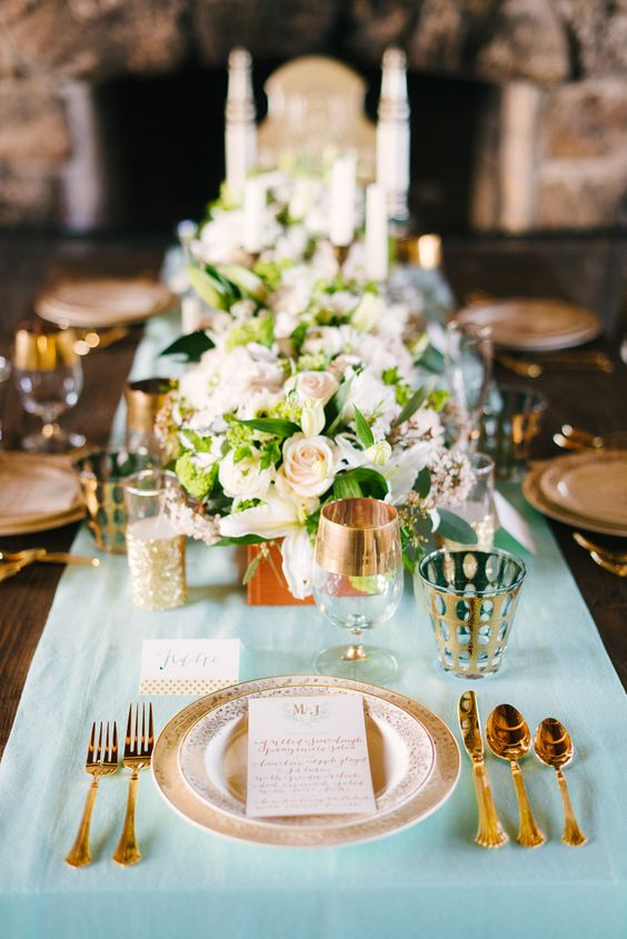 mint table with gilded glasses and tableware
