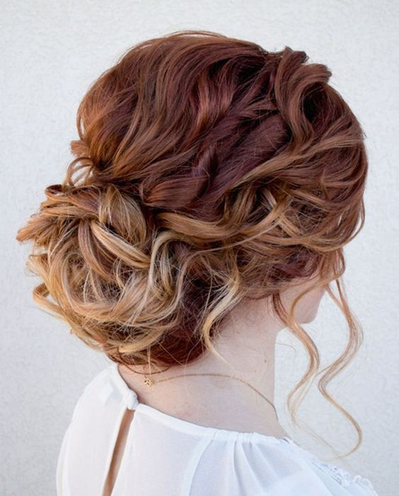 wavy messy updo with locks to frame the face