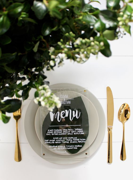 greenery, grey dishes and an acrylic menu for a chic modern look