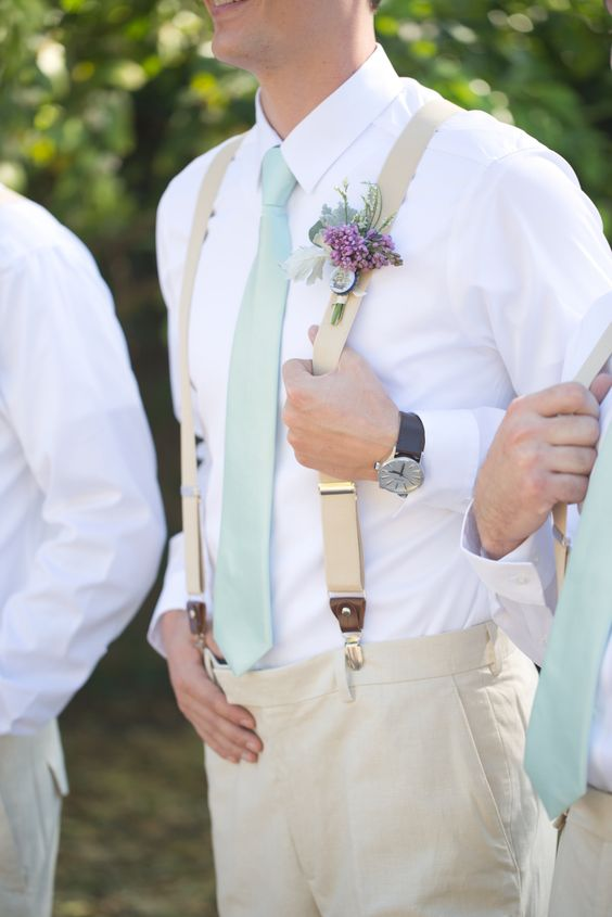 neutral groom's look with a mint tie and a lavender boutonniere