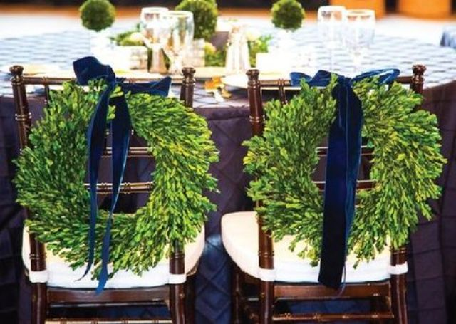 wreath with velvet bows that mark the newlyweds' seats