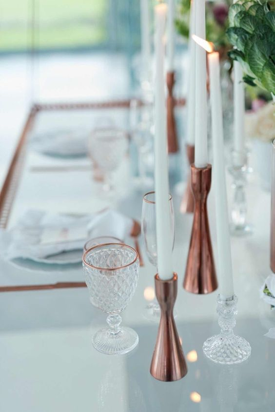 copper candle holders and edges make this modern table setting refined