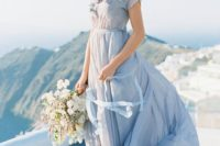 17 gentle blue flowy wedding gown with floral appliques
