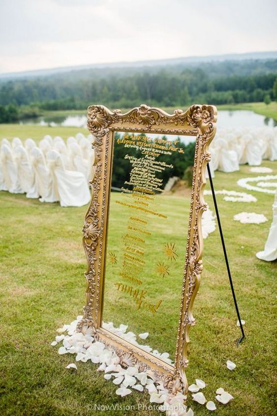 rustic mirror wedding seating chart in an antique frame