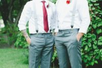 18 grooms in grey pants, with red boutonnieres and ties