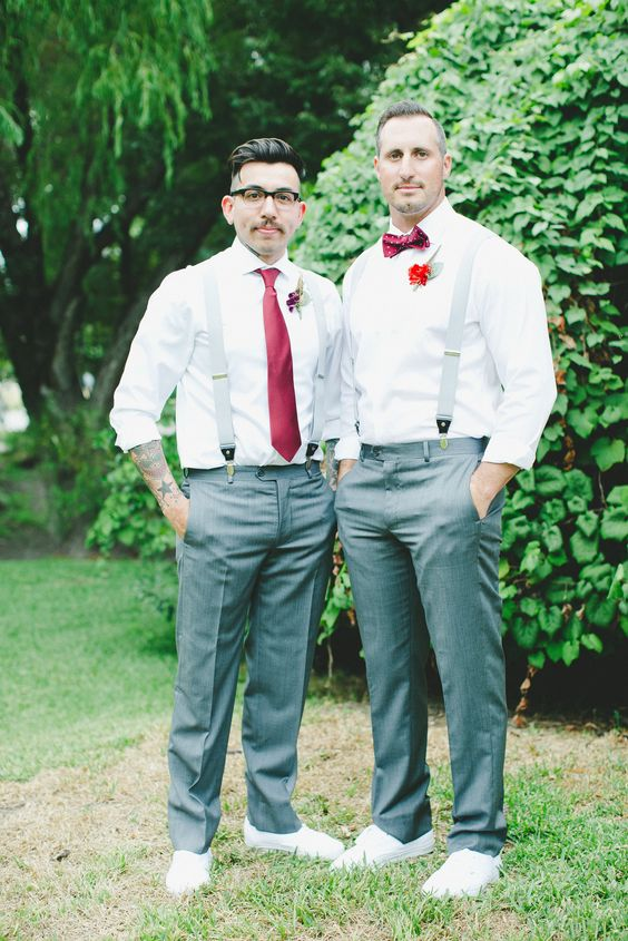 grooms in grey pants, with red boutonnieres and ties