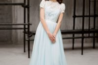 18 light blue wedding gown with a lace top and short sleeves