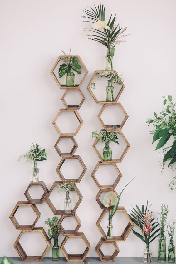 modern wedding decor of wooden hexagons and greenery
