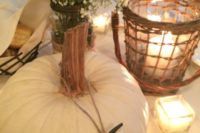 18 table number hanging on a white pumpkin for fall nuptials