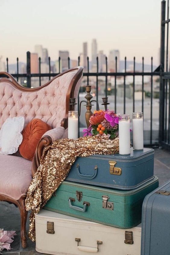vintage suitcases and candles for a retro glam wedding