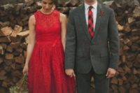 19 bride in bold red and groom in dark grey and red