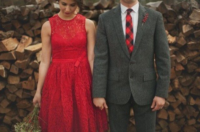 bride in bold red and groom in dark grey and red