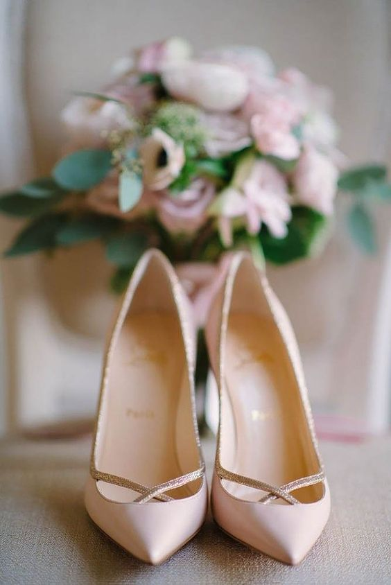 gorgeous blush bridal shoes and a bouquet