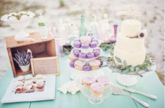 mint dessert table with purple and lavender food