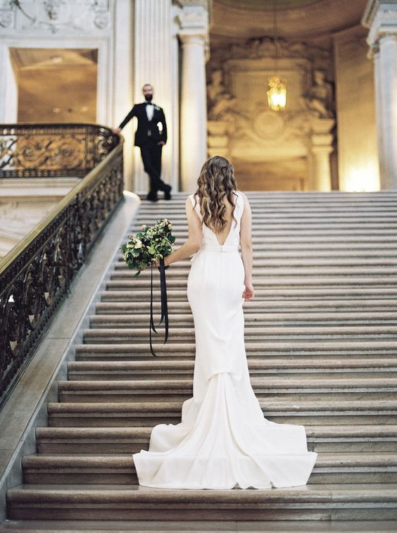 modern wedding dress with a train and a statement back