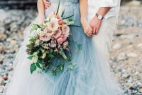 19 tulle wedding dress with a sweetheart neckline and an emblished belt