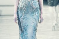 20 blue heavily embellished wedding gown with a plunging neckline
