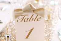 20 gold calligraphy table numbers with bows