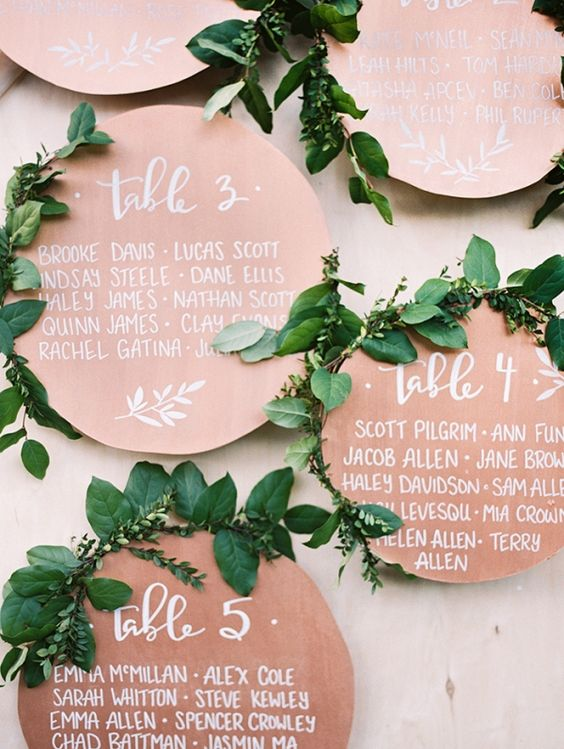 copper seating circles with wwhite calligraphy look very elegant