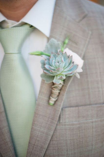light grey groom's suit, a mint tie and a succulent boutonniere