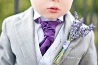 21 ringbearer in a light grey suit with a purple tie and a lavender boutonniere