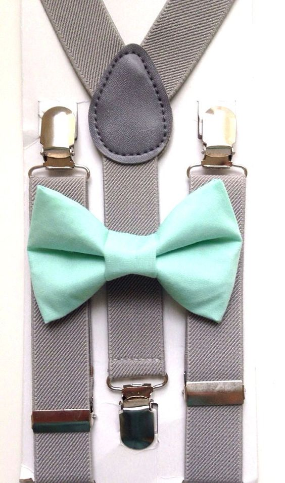 a mint bow tie and grey suspenders
