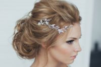 22 messy updo with a crystal tiara