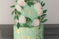22 mint wedding cake with gold leaf and flowers