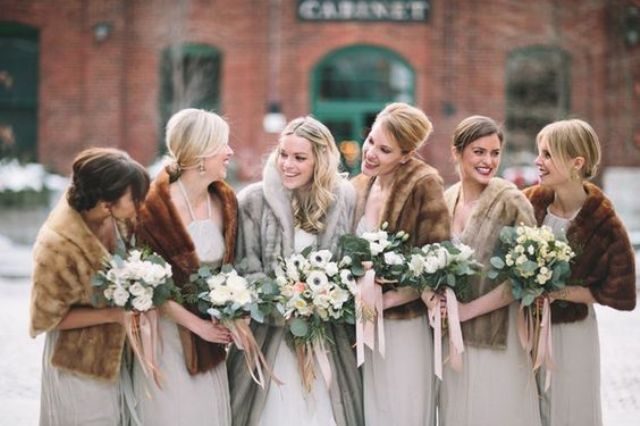 mismatched fur stoles for bridesmaids and a bride in a fur coat