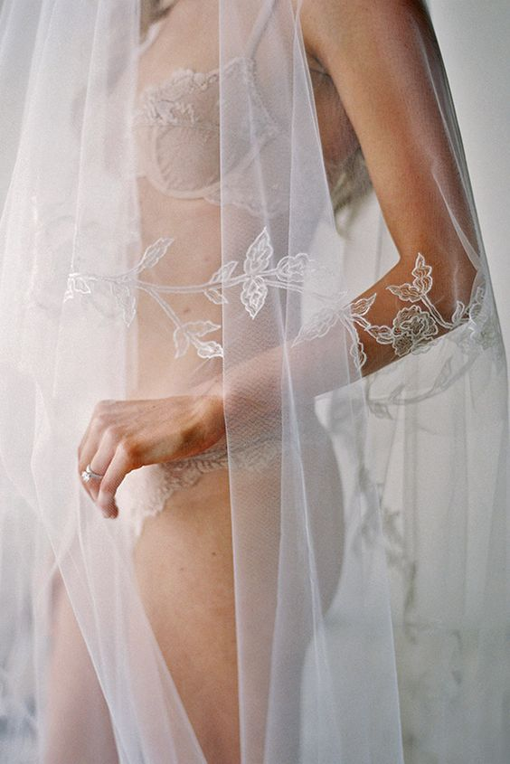 showing off your bridal lingerie and veil