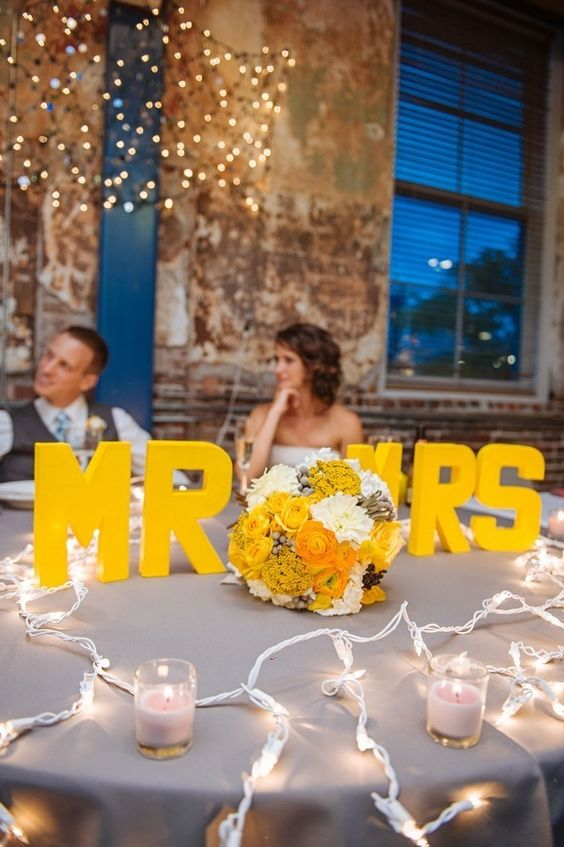 silver grey tablecloth, yellow monograms