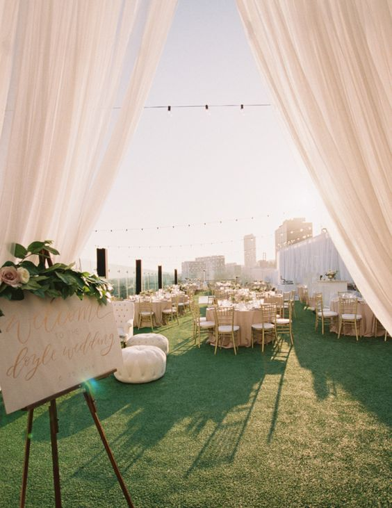 blush and gold rooftop decor and moss all over