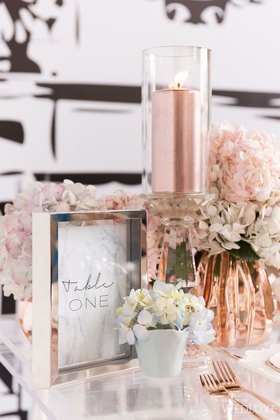 copper vases and tableware mixed with white flowers look good