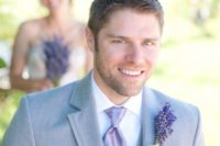 23 grey groom's suit with a lavender boutonniere and accessories