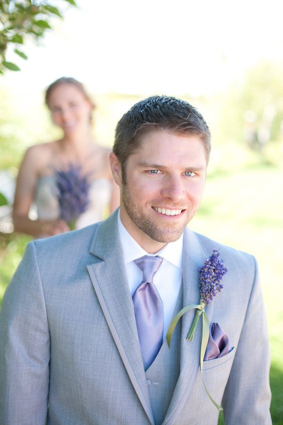 grey groom's suit with a lavender boutonniere and accessories