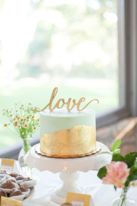 one-tier mint wedding cake with gold leaf and a cake topper