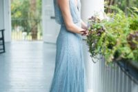 23 serenity blue heavily embellished wedding dress with a plunging neckline
