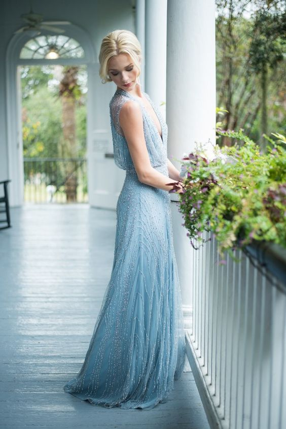 serenity blue heavily embellished wedding dress with a plunging neckline