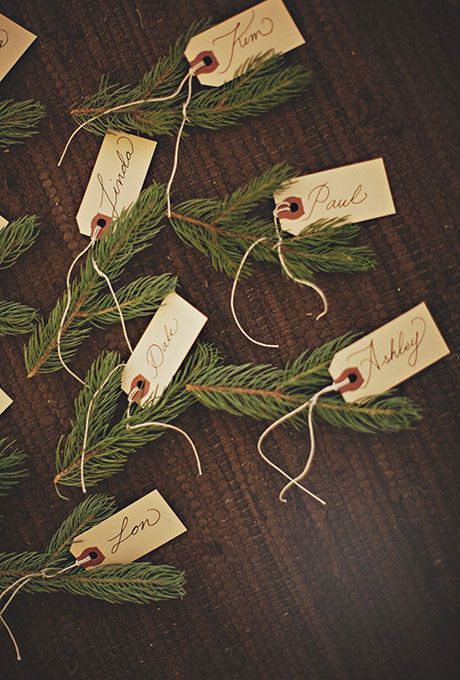 winter wedding place cards with fir branches