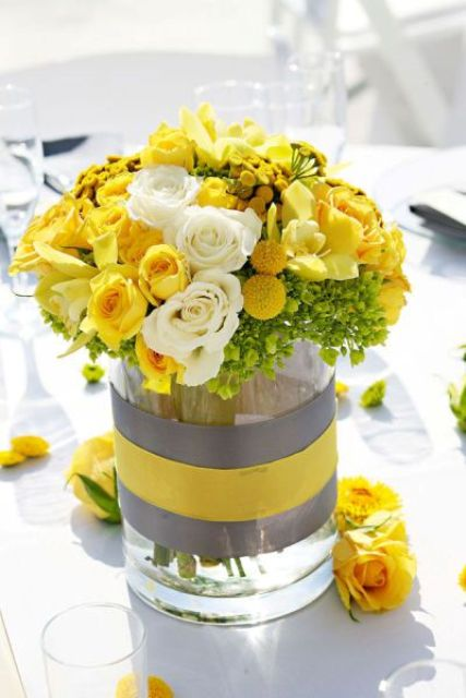 yellow and grey centerpiece with lush flowers