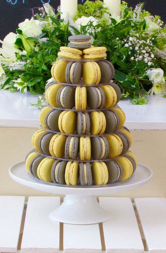 a macaron tower for a summer or spring weddings in grey and yellow