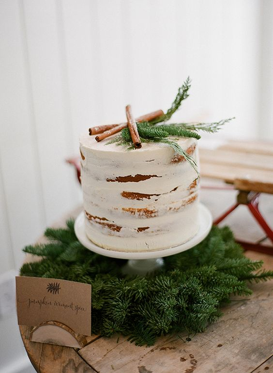 display a cake on a fir wreath to give it a cool rustic look