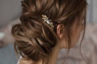 24 messy updo with a small crystal accessory for an accent