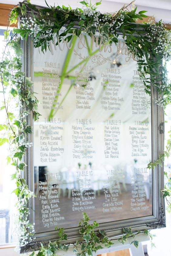 mirror seating plan with foliage and flowers